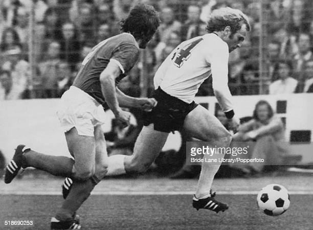 Uli Hoeneß of West Germany is pursued by Lothar Kurbjuweit of East Germany during their World Cup Group 1 match at the Volksparkstadion Hamburg...