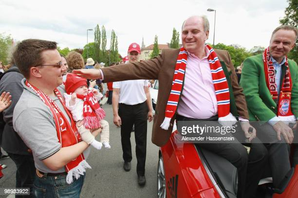 Uli Hoeness president of Bayern Muenchen and KarlHeinz Rummenigge CEO of Bayern Muenchen celebrate the German championship on the way to the...