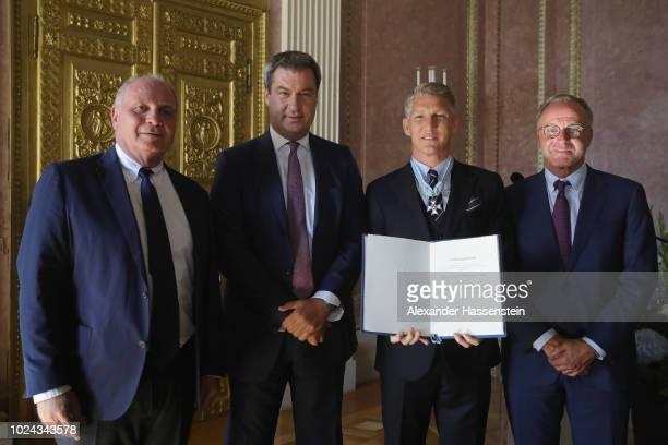 Uli Hoeness President of Bayern Muenchen Bavarian Prime Minister Dr Markus Soeder Bastian Schweinsteiger and KarlHeinz Rummenigge honors Bastian...