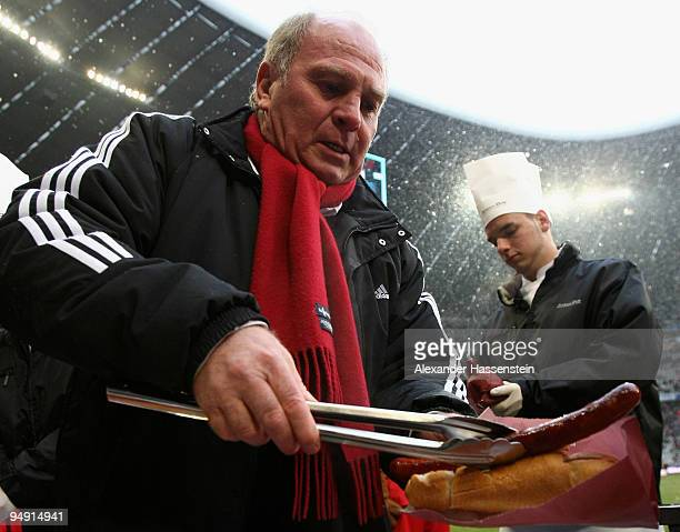 Uli Hoeness President of Bayern Muenchen fries sausages for the supporters prior to the Bundesliga match between Bayern Muenchen and Hertha BSC...