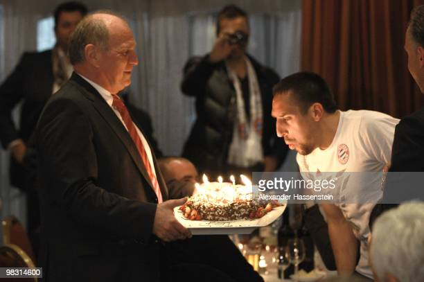 Uli Hoeness President of Bayern Muenchen presents Franck Ribery a birthday cake for his 27 birthday during the Champions League dinner at the...