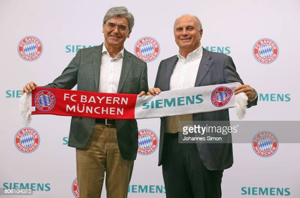 Uli Hoeness president of Bundesliga football club FC Bayern Muenchen and Joe Kaeser CEO of Siemens address the media during a press conference...