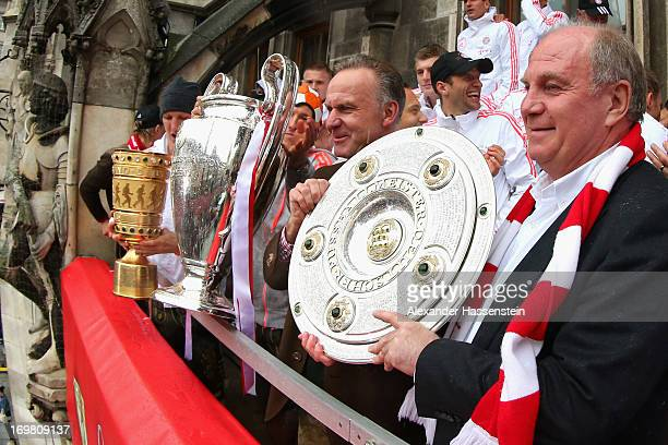Uli Hoeness President of FC Bayern Muenchen celebrate winning Bundesliga trophy KarlHeinz Rummenigge with Champions League winners trophy and Bastian...