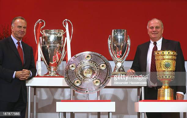 Uli Hoeness President of FC Bayern Muenchen poeses with KarlHeinz Rummenigge CEO of FC Bayern Muenchen next to the UEFA Champions League winners...