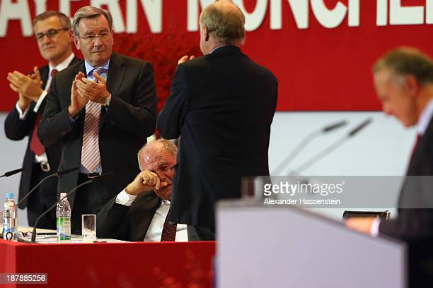 Uli Hoeness President of FC Bayern Muenchen reacts whilst JanChristian Dreesen CFO of FC Bayern Muenchen Karl Hopfner Board Member of FC Bayern...