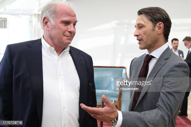 Uli Hoeness, President of FC Bayern Muenchen smiles with his head coach Niko Kovac during a reception of the Bundesliga champion and DFB Cup winner...