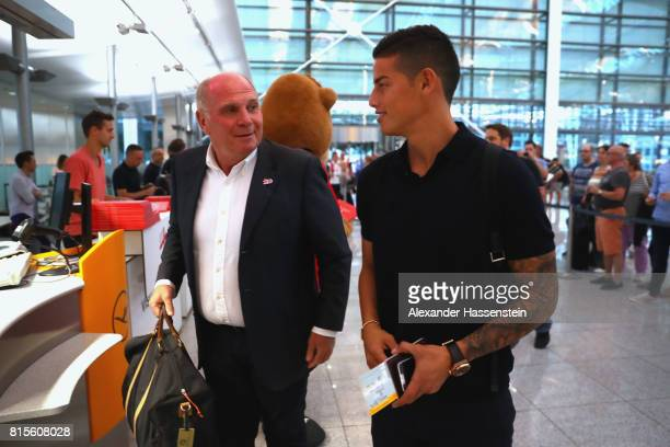 Uli Hoeness President of FC Bayern Muenchen talks to James Rodriguez prior their team flight to Shanghai for the FC Bayern Muenchen PreSeason Tour on...