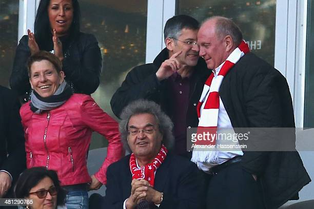 Uli Hoeness talks to Herbert Hainer Supervisory Board Chairman of the FC Bayern Munich AG during the Bundesliga match between FC Bayern Muenchen and...