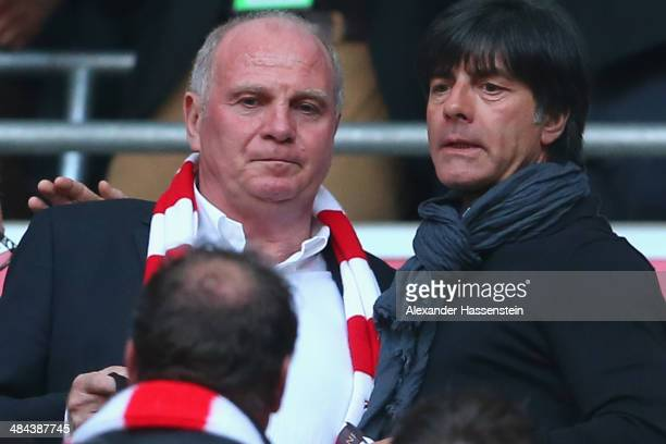 Uli Hoeness talks to Joachim Loew head coach of the German national team prior to the Bundesliga match between FC Bayern Muenchen and BVB Borussia...