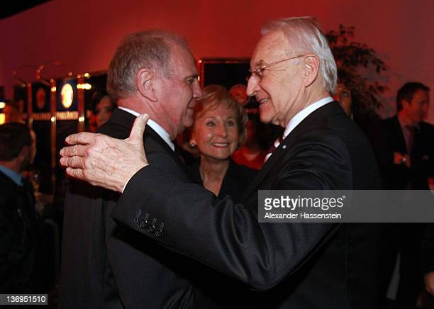 Uli Hoeness welcomes Edmund Stoiber and Karin Stoiber at Uli Hoeness' 60th birthday celebration at Postpalast on January 13 2012 in Munich Germany