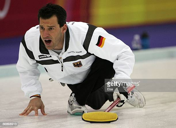 Uli Kapp of Germany directs his sweepers during the preliminary round of the men's curling between Switerland and Germany during Day 7 of the Turin...