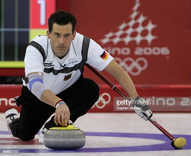 Uli Kapp of Germany throws the stone during the preliminary round of the men's curling between New Zealand v Germany during Day 10 of the Turin 2006...