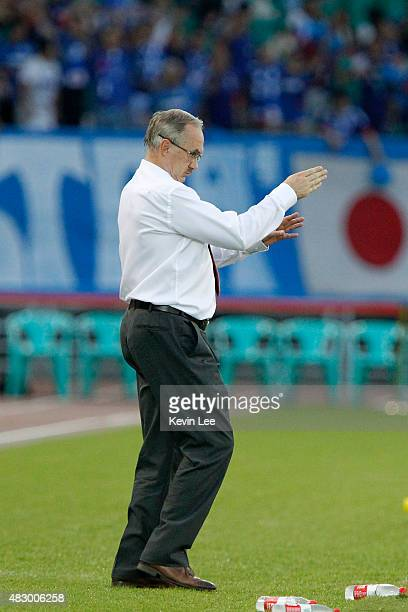 Uli Stielike coach of the Korea Republic gestures in a match against Japan during EAFF East Asian Cup 2015 final round in Wuhan Sports Center Stadium...