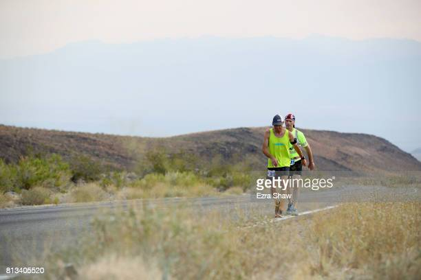 Uli Stuwe of Germany runs with a member of his support team during the STYR Labs Badwater 135 on July 11 2017 in Death Valley California Stuwe...
