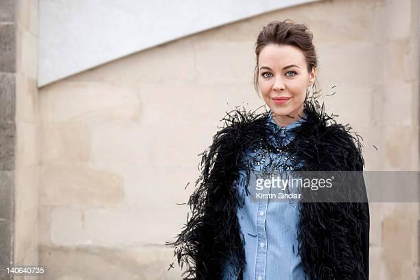 Uliana Sergeenko Fashion designer wearing a Vintage 1968 YSL jacket Zara jeans and shirt Lanvin necklace at Paris Fashion Week Autumn/Winter 2012...