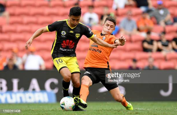 Ulises Alejandro Davila Plascencia of the Phoenix and Scott Neville of the Roar challenge for the ball during the round 15 A-League match between the...