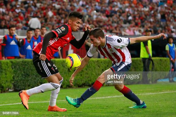 Ulises Cardona of Atlas and Alejandro Mayorga of Chivas compete for the ball during the 16th round match between Atlas and Chivas as part of the...