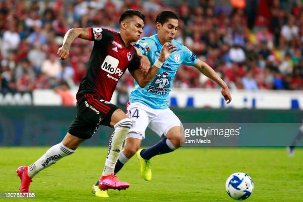 Ulises Cardona of Atlas fights for the ball with Erick Aguirre of Pachuca during the 7th round match between Atlas and Pachuca as part of the Torneo...