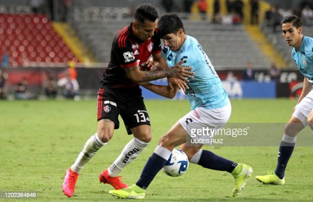 Ulises Cardona of Atlas vies for the ball with Miguel Tapias of Pachuca during the Mexican Clausura 2020 tournament football match at Jalisco Stadium...