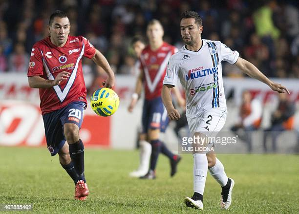 Ulises Corral of Queretaro vies for the ball with Fernando Meneses of Veracruz during their Mexican Clausura tournament football match at the Luis...
