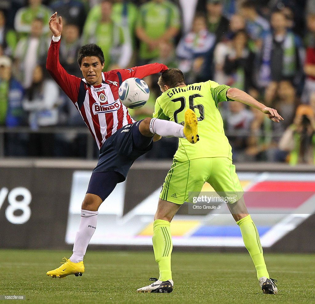 Ulises Davila #11 of Chivas de Guadalajara battles against Taylor Graham #26 of the Seattle Sounders FC on October 12, 2010 at Qwest Field in Seattle, Washington. The Sounders defeated Chivas de Guadalajara 3-1.