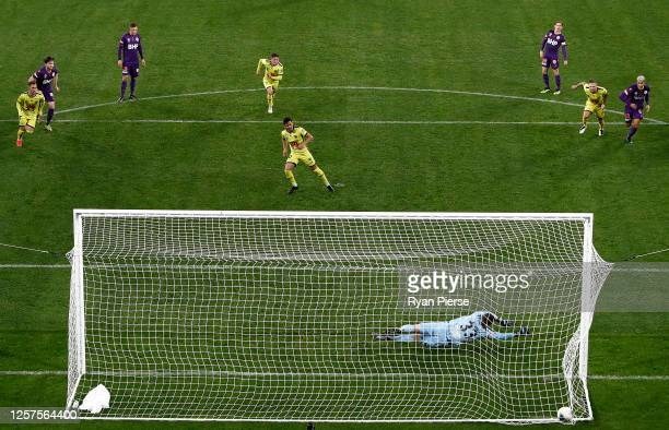Ulises Davila of the Phoenix scores his teams second goal past Liam Reddy of the Glory during the round 21 A-League match between Perth Glory and...