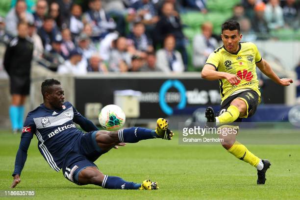 Ulises Davila of the Phoenix shoots under pressure during the Round 5 A-League match between Melbourne Victory and the Wellington Phoenix at AAMI...