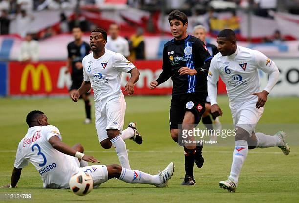 Ulises de la Cruz Jorge Guagua and Geovany Caicedo of Liga Deportiva Universitaria from Ecuador struggles for the ball with Alvaro Navarro of Godoy...