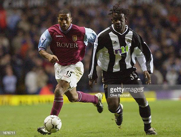 Ulises De La Cruz of Aston Villa challenges Olivier Bernard of Newcastle United tackles Darius Vassell of Aston Villa during the FA Barclaycard...