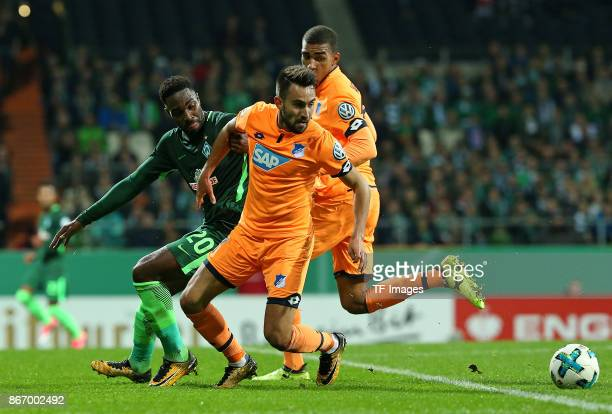 Ulisses Garcia of Bremen and Lukas Rupp of Hoffenheim Kevin Akpoguma of Hoffenheim battle for the ball during the DFB Cup match between Werder Bremen...