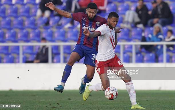 Ulisses Oliveira of UD Vilafranquense with Gustavo Costa of CD Cova da Piedade in action during the Liga Pro match between CD Cova da Piedade and UD...