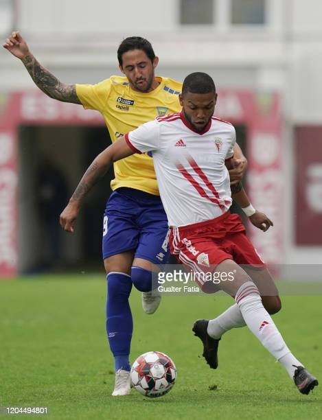 Ulisses Oliveira of UD Vilafranquense with Joao Diogo of GD Estoril Praia in action during the Liga Pro match between GD Estoril Praia and UD...