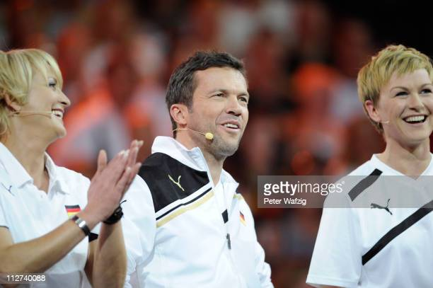 Ulla Kock am Brink Lothar Matthaeus and Karen Heinrichs of team Germany laugh during the 'Deutschland Gegen Italien' TV Show on April 20 2011 in...