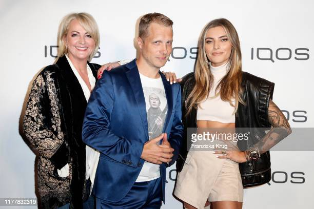 Ulla Kock am Brink Oliver Pocher and Sophia Thomalla during the IQOS store opening event on October 23 2019 in Frankfurt am Main Germany