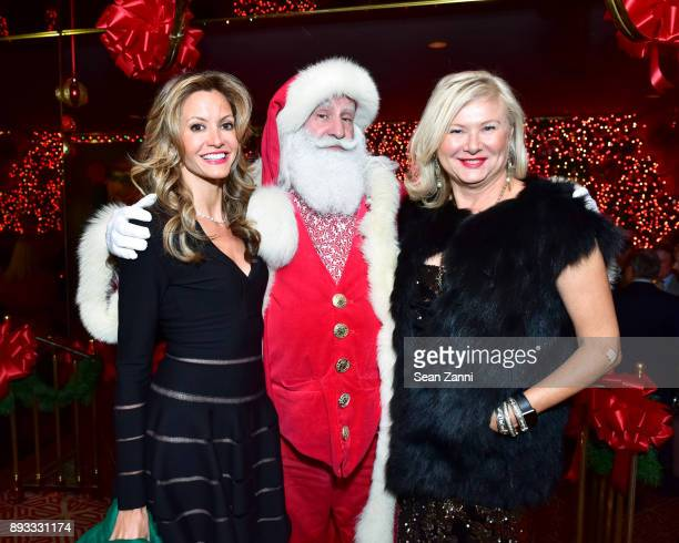 Ulla Parker Santa Claus and Liliana Cavendish attend A Christmas Cheer Holiday Party 2017 Hosted by George Farias and Anne and Jay McInerney at The...