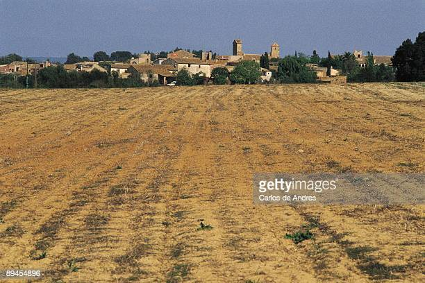 Ullastret Panoramic view of Ullastret from the plowed fields county of Gerona
