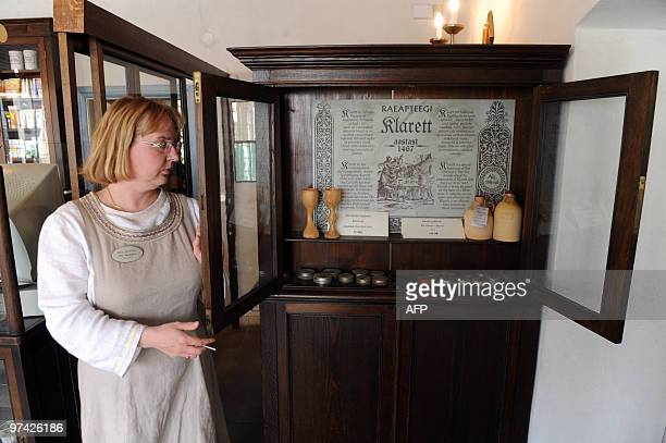 REIGAS Ulle Noodapera a pharmacist at the Raeapteek drug store which first opened for business in Tallinn's old town square in 1422 stands next to a...