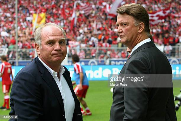 Ulli Hoeness former manager of Muenchen talks to head coach Louis van Gaal head of Muenchen poses prior to the Bundesliga match between Borussia...