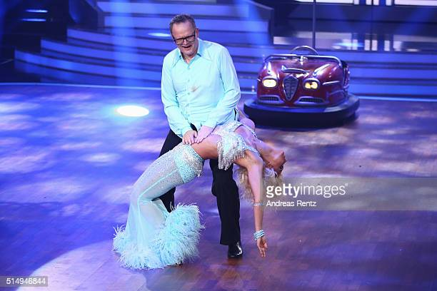 Ulli Potofski and Kathrin Menzinger perform on stage during the 1st show of the television competition 'Let's Dance' on March 11 2016 in Cologne...
