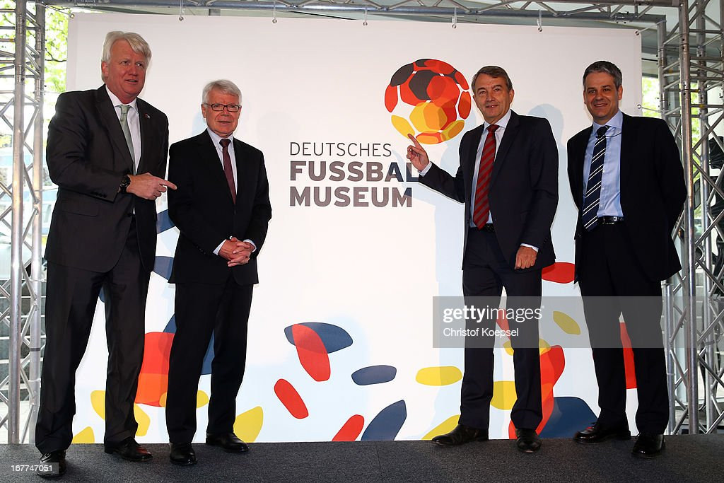 Ullrich Sierau, mayor of Dortmund, Reinhard Rauball, president of the DFL, Wolfgang Niersbach, president of the German Football Association and Manuel Neukircher, director foundation DFB football museum present the official logo of the DFB Football Museum during the DFB Football Museum groundbreaking ceremony at Harenberg City Center on April 29, 2013 in Dortmund, Germany.