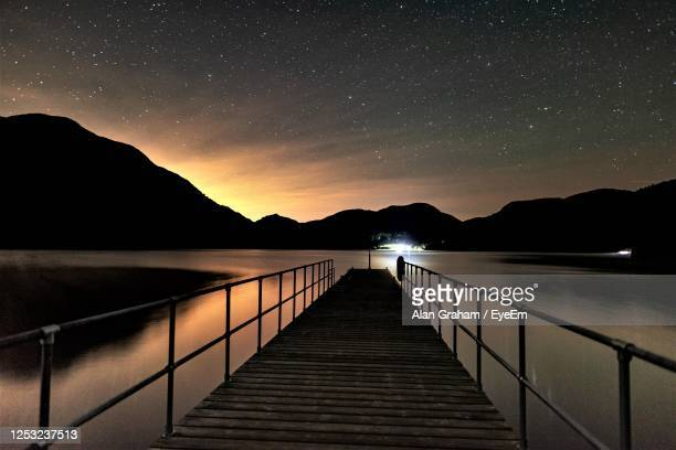 ullswater from aira force steamer pier at night - passenger craft stock pictures, royalty-free photos & images
