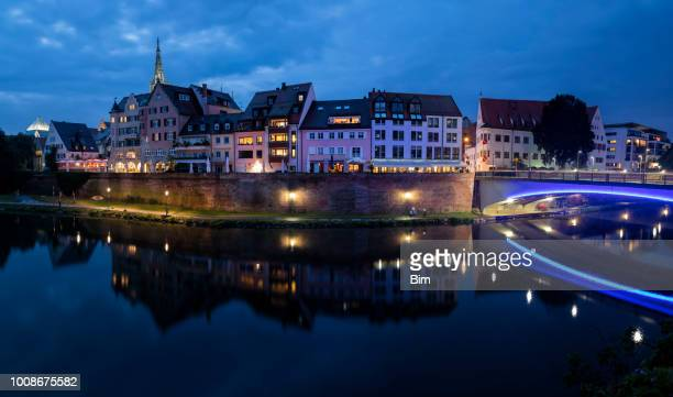 ulm, skyline at night - minster stock photos and pictures