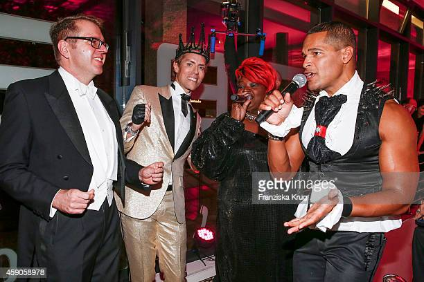 Ulrich Schuhmacher Jens Hilbert Dynelle Rhodes and Jimmie Wilson attend the Hairfree Celebrates 10 Year Anniversary with Bal Masque on November 15...