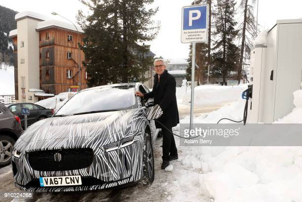Ulrich Spiesshofer chief executive officer of the ABB Group charges a Jaguar IPACE electric automobile at an ABB charging station on January 25 2018...