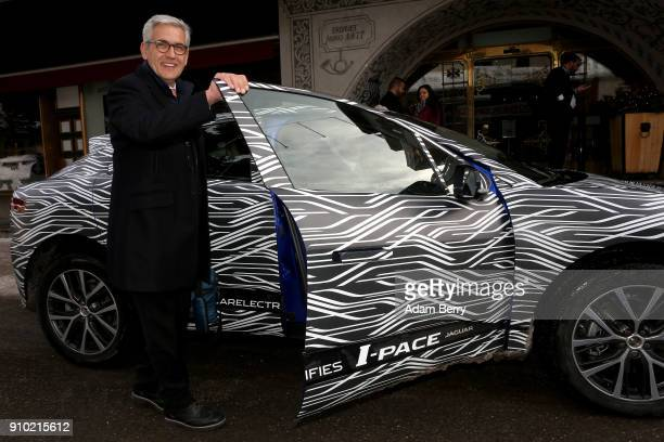Ulrich Spiesshofer chief executive officer of the ABB Group gets inside a Jaguar IPACE electric automobile on January 25 2018 in Davos Switzerland...