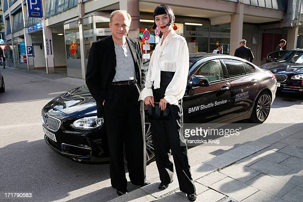 Ulrich Tukur and his wife Katharina John attend the opening of the 'Munich Film Festival 2013' at the Mathaeser Cinema on June 28 2013 in Munich...