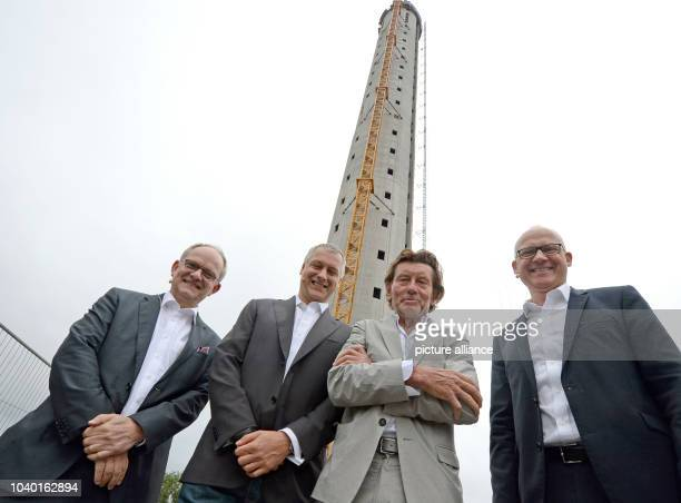 Ulrich Weinmann chairman of the Zueblin AG Andreas Schierenbeck CEO of the ThyssenKrupp Elevator AG architect Helmut Jahn and Rottweil's mayor Ralf...