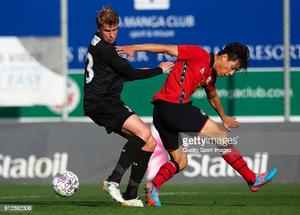 Ulrik Jenssen of Nordsjaelland competes for the ball with Park Chu Young of Seoul during the friendly match between FC Nordsjaelland and FC Seoul at...