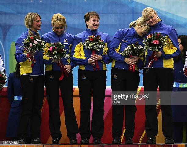 Ulrika Bergman Anna Svaerd Catherine Lindahl Eva Lund and Anette Norberg of Sweden pose with flowers after winning gold during the gold medal match...