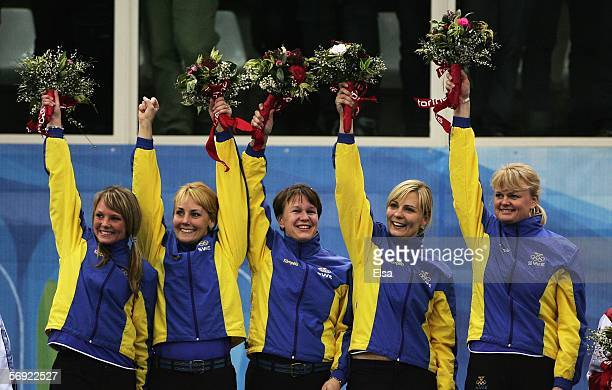 Ulrika Bergman Anna Svaerd Catherine Lindahl Eva Lund and Anette Norberg of Sweden celebrate winning gold during the gold medal match of the women's...